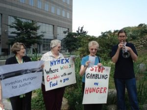 IASJ and Maryknoll Sisters protesting the role of agricultural commodities in contributing to hunger