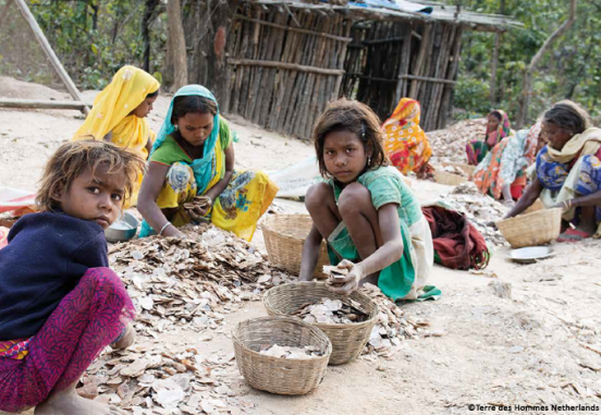 Children sorting mica chips in Indian mine - Terre des hommes